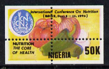 Nigeria 1992 Conference on Nutrition - 50k (Fruit & Vegetables) unmounted mint with vert & horiz perfs misplaced (divided along margins so stamp is quartered)*