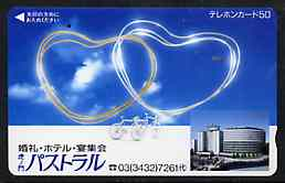 Telephone Card - Japan 50 units phone card showing Bicycle and two Hearts