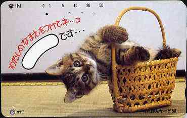 Telephone Card - Japan 50 units phone card showing Kitten falling out of Basket (card dated 1.4.1990)