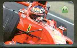 Telephone Card - Michael Schumacher �20 phone card (showing MS in Ferrari viewed from front), stamps on cars    racing cars      ferrari, stamps on shells