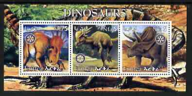 Eritrea 2002 Dinosaurs #03 perf sheetlet containing set of 3 values each with Rotary Logo unmounted mint