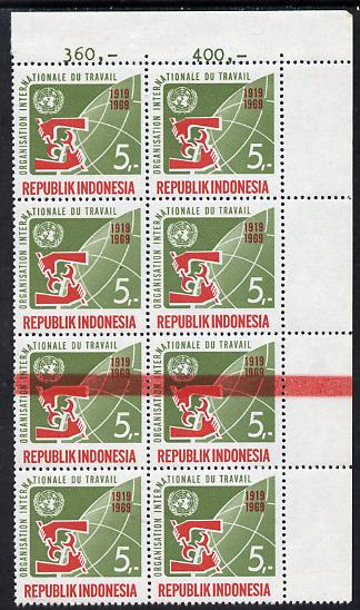 Indonesia 1969 ILO 5r block of 8 with superb 5mm wide doctor blade flaw across two stamps, unmounted mint (SG 1219var)