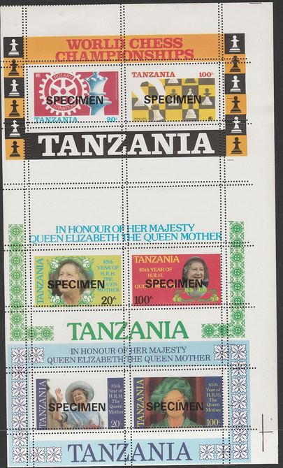 Tanzania 1986 Chess & Rotary, the unissued m/sheet (showing the Chess Championship Emblem) se-tenant with the two Queen Mother m/sheets (inscribed in error HRH) all  overprinted SPECIMEN and showing double perforations, unmounted mint. A remarkable piece from the Printer's archives