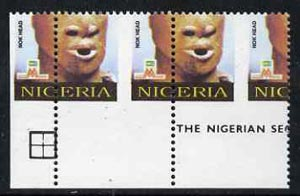 Nigeria 1993 Museum & Monuments 10n (Nok Head) with vert & horiz perfs misplaced, divided along perforations to show parts of 4 stamps unmounted mint, SG 663var