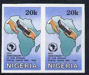 Nigeria 1990 Pan African Postal Union 20k (Map & Parcel) unmounted mint imperf pair as SG 587