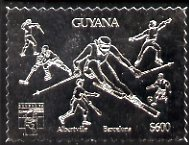 Guyana 1992 'Genova 92' International Thematic Stamp Exhibition $600 perf embossed in silver foil featuring Albertville & Barcelona Olympics and showing Fencing, Ice Hockey, Skiing, Baseball, Football & Ice Skating (Dancing)
