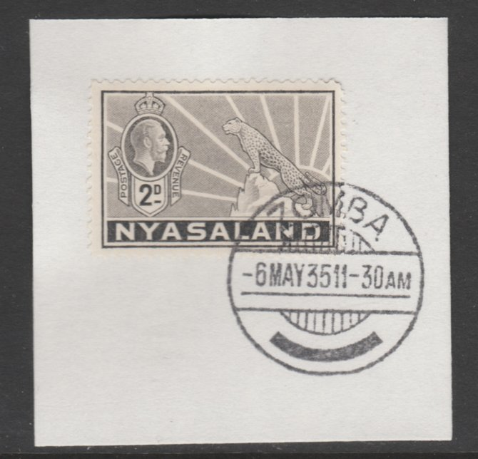 Nyasaland 1934-35 KG5 Leopard Symbol 2d pale grey SG 117 on piece with full strike of Madame Joseph forged postmark type 314