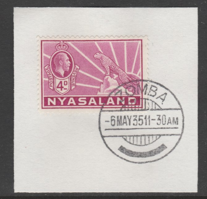 Nyasaland 1934-35 KG5 Leopard Symbol 4d magenta SG 119 on piece with full strike of Madame Joseph forged postmark type 314