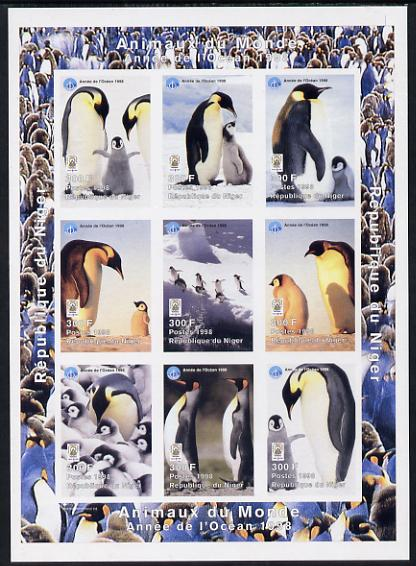 Niger Republic 1998 Animals of the World #5 (Penguins) imperf sheetlet containing 9 x 300f values each with Year of the Ocean logo unmounted mint. Note this item is privately produced and is offered purely on its thematic appeal as Scott #1010